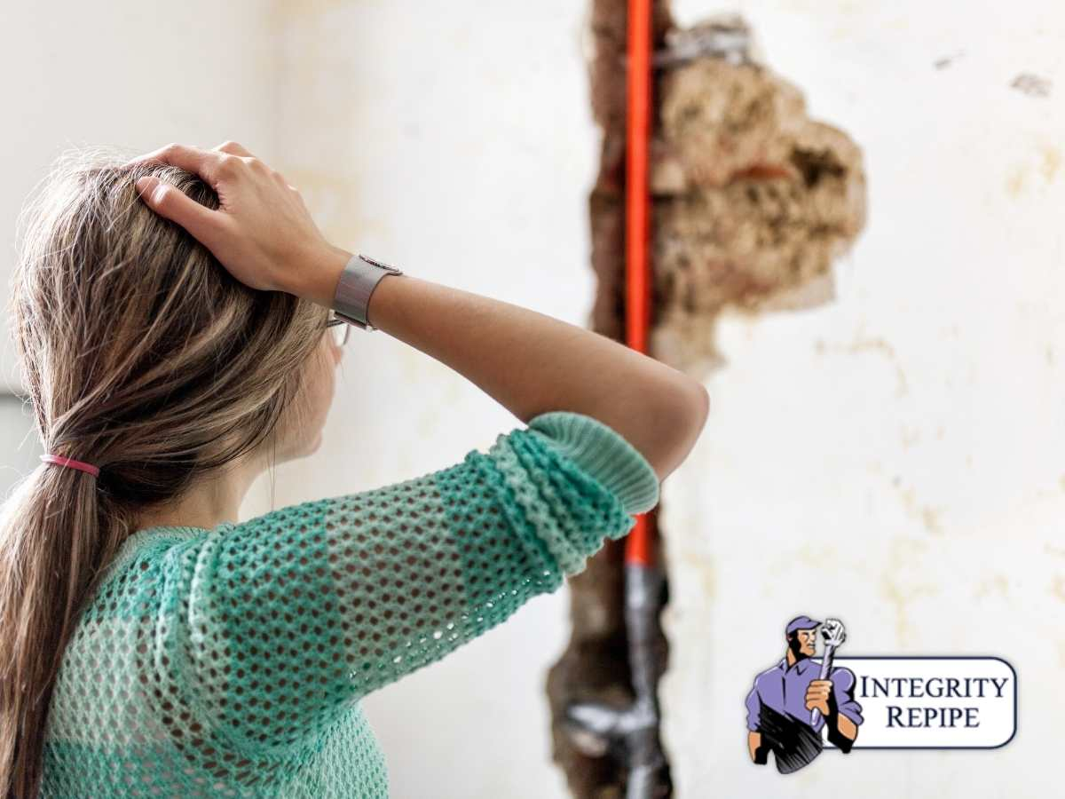Stressed Out Woman Looking At Plumbing Leak Damage In California