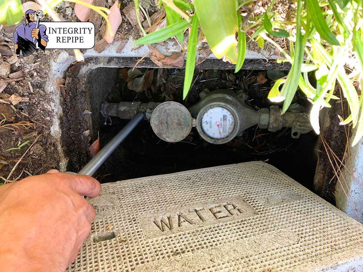 Professional Repiping plumber fixing an underground pipe leak in San Clemente, CA