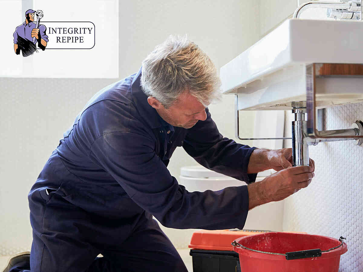 A repipe plumber doing a professional plumbing inspection in Ladera Ranch, CA.